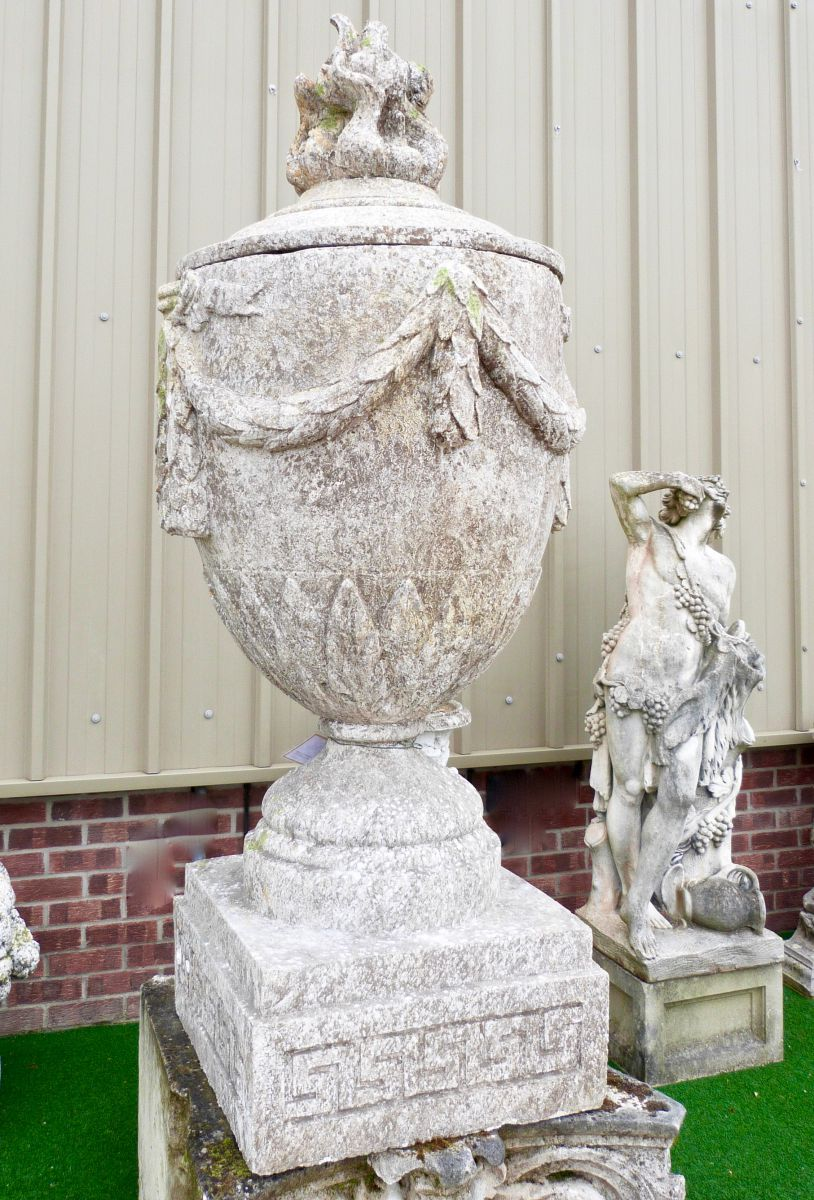 Pair Of Large Decorative Urns With Swag Decoration Stock