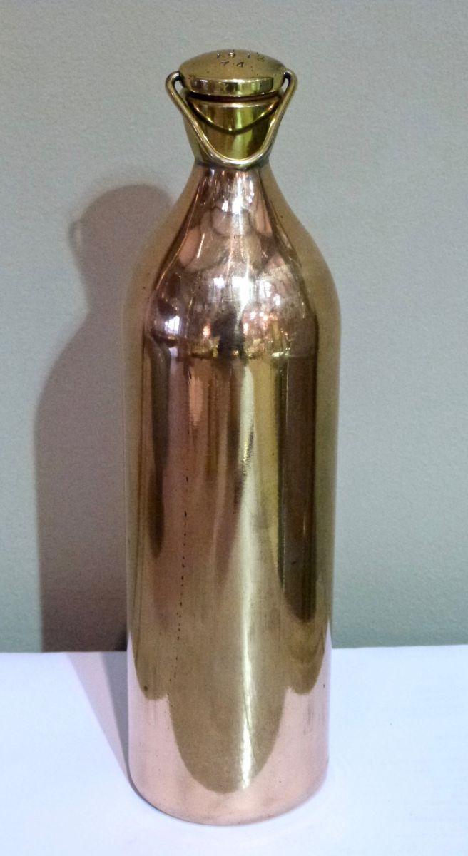 A Military Artillery Heavy Gun Copper Oil Bottle Stock